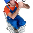 Builder with megaphone sat in trolley — Stock Photo #8106638