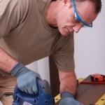 Handyman drilling a hole through a board — Stock Photo