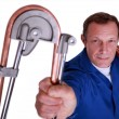 Stock Photo: Plumber bending copper piping