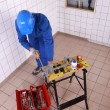 Top view of plumber cutting plastic pipe - Stockfoto