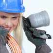 Blond woman with blowtorch and copper pipe — Stock Photo #8107103