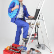 Stock Photo: Plumber on stepladder