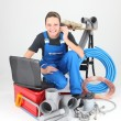Female plumber knelt down by equipment — Stock Photo #8107352