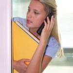 Secretary talking on the phone — Stock Photo