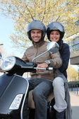 Friends having a ride on scooter — Stock Photo