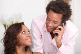 Couple making telephone call — Stock Photo