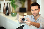 Man playing a video game — Stock Photo