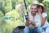 Romantic couple fishing on the river — Stock Photo
