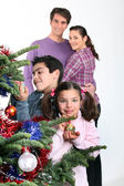 Family gathered around Christmas tree — Stock Photo