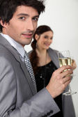 Elegant man drinking champagne — Stock Photo