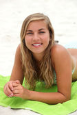 Portrait of a young woman on the beach — Stock Photo
