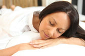 Woman sleeping in her bed — Stock Photo