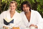 Couple having breakfast in the garden — Stock Photo