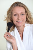 Woman with blusher brush — Stock Photo