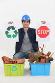 Construction worker encouraging to recycle waste — Stock Photo