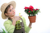 Little girl spraying a houseplant — Stock Photo