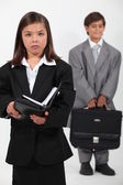 Kids dressed as businesspeople — Stock Photo