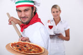 Pizza cook and a waitress — Stock Photo