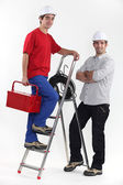 Electricians and a stepladder — Stock Photo