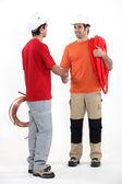 Plumbers shaking hands — Stock Photo