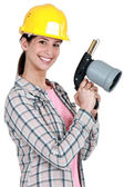 Woman holding blow-torch — Stock Photo