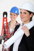 A female architect and a female builder — Stock Photo