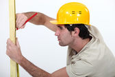 Carpenter marking plank — Stock Photo