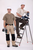 Two handyman with their driller. — Stock Photo