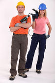 Man and woman with power drills — Stock Photo