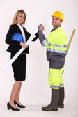 Engineer and a construction worker making a pact — Stock Photo