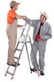 Decorators shaking hands — Stock Photo
