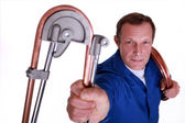Plumber bending copper piping — Stock Photo