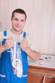 Smiling plumber — Stock Photo