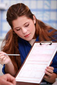 Young female apprentice giving explanations about a document — Stock Photo