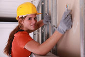 Builder installing electrical wiring — Stock Photo