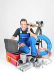 Female plumber knelt down by equipment — Stock Photo