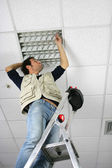 Man replacing ceiling panel — Stock Photo