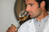 A man smelling wine — Stock Photo