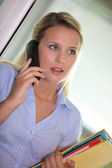 Secretary talking on the phone — Stock Photo