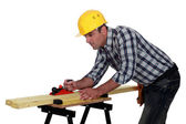 Builder planning wood — Stock Photo
