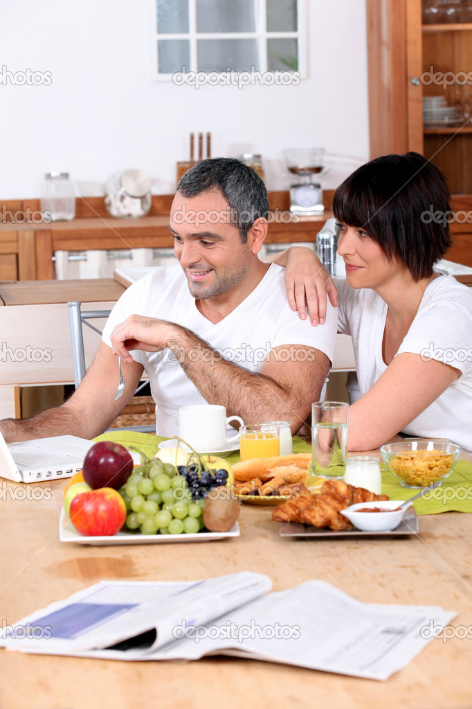 Couple having breakfast together  Stock Photo #8101114