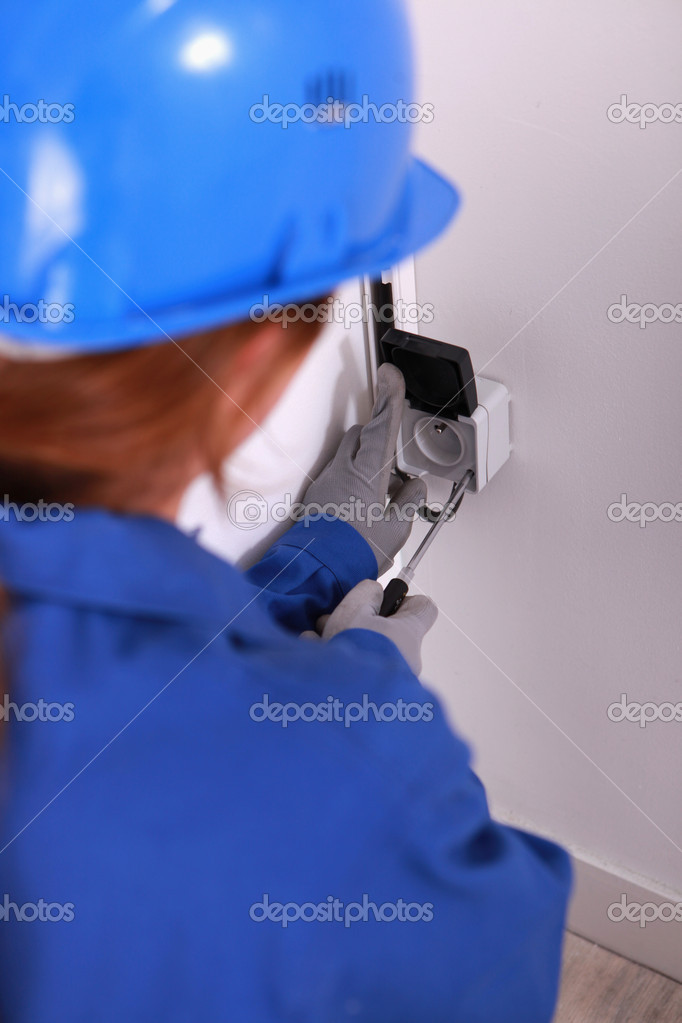 Female electrician installing a continental socket  Stock Photo #8107056
