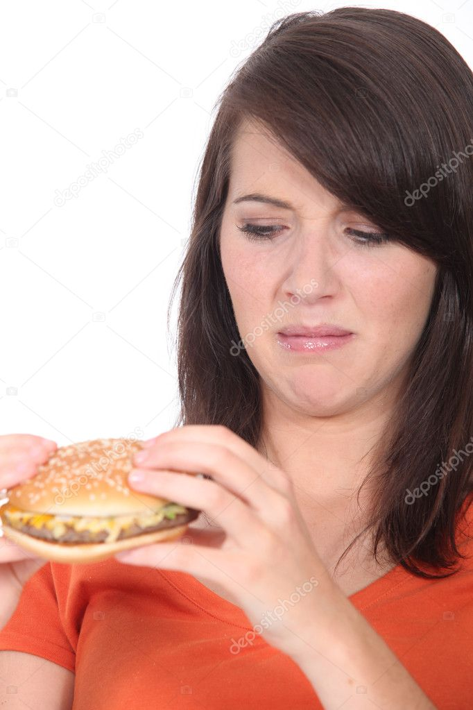 Woman stood holding cheeseburger — Stock Photo #8107554