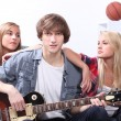 Teenagers playing the guitar — Stock Photo #8110415