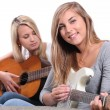 Girls playing the guitar — Stock Photo