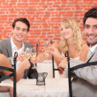 Friends having dinner together - Stock Photo