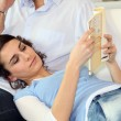 Woman lying on her boyfriend — Stock Photo