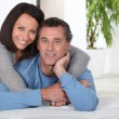 Couple leaning on bed — Stock Photo