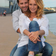 Stock fotografie: Couple by the waterside
