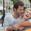 Couple laughing with joy on a shopping trip — Stock Photo